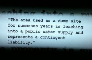 "Clip from Ford documents stating, ""The area used as a dump site for numerous years is leaching into a public water supply and represents a contingent liability."""